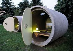 Capsule hotel room made from a sewer pipe.