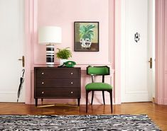 Pale pink walls prove the perfect backdrop for a jewel-toned green chair to make a statement.