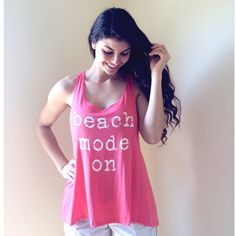 ❗️SALE❗️Beach Mode On Statement Tank Adorable coral statement tank.  Modeling size S.  Price firm unless bundled.                                                                ▪️95% Rayon 5% Spandex.                                                ▪️Dry clean.    ▪️Made in the USA🇺🇸.               🚫Trades Boutique Tops Tank Tops
