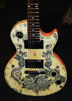 """You can paint or spray a guitar or apply woodcutting techniques but you can also simply use Sharpie permanent markers. They call it """"Sharpie a guitar"""". Now this has been and still is popular among certain creative minds. You can find videos on You Tube called """"How to Sharpie a guitar""""."""