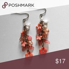 "Coral and White Beaded Earrings These darling Beaded earrings are a perfect accessory to brighten any outfit! Features flower beads with diamond-like centers, detailed leaves, bevel cut beads and mini white pearls. 2"" Long Jewelry Earrings"