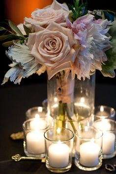 Dahlias and roses make this an elegant piece. Note that it could be doubled as a bouqet as well as a centerpiece.