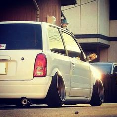 Team Hula's Daihatsu Cuore with stance wheels