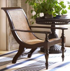 Caning adds a tropical feel to a graceful wood frame chair