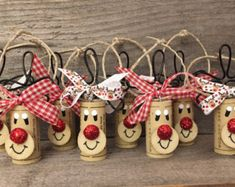 This listing is for a Set of 4 Wine Cork Rudolph Ornaments tied with a red & white ribbon. They will come packaged as a gift set. Here are just a few ideas of what these ornaments can be used for: -Wine Lovers Gift Set -Wine Bottle Charms - Add one to every wine bottle you give as a gift! -Christmas Party Favors -Cookie Swap Favors/Decor -Christmas Tree Ornaments -Gift Wrap Embellishment This is cork recycling at its best! These adorable Reindeer and Snowmen are handmade from 100%…