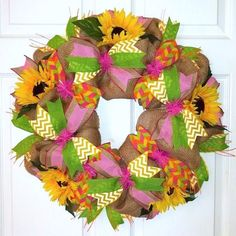 New! Summer Sunflower Citrus Wreath is the perfect piece to celebrate summer.  Rustic burlap is the backdrop to the summer berry, lime, lemon & orange citrus colors.  Chevron, polkadot & solid ribbons combine with yellow silk sunflowers to evoke the perfect summer feel.  This wreath measures approximately 26 inches across and approximately 6 inches deep.