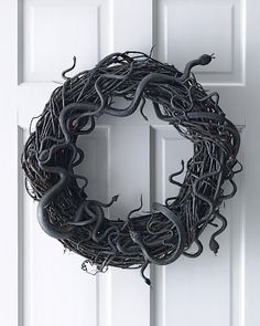 Snakes wreath. Use cheap rubber snakes, spray paint a  grapevine wreath and the snakes. Hot glue the snakes to the wreath. Hang.