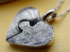 Personalized his and hers fingerprint necklas on Etsy