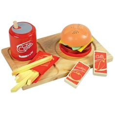 "Santoys ST706 Wooden Play Food Fast Food Set - All children love the treat of being able to eat out at a fast food restaurant. So how about bringing one home with you? This fun fast food set includes a bag of fries, can of fizzy drink, tomato sauce, chilli sauce and a burger complete with bun, tomato and cheese. One of many great items from Earlybird Toys - Please see our storefront on Amazon for full details. Sold by Earlybird Toys, proud to be rated ""Excellent"" by Amazon's"
