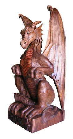 Female Dragon Carving--- I would love a couple of these in different sizes. A couple for the mantle and some for the drive way and some for the porch. So beautiful/