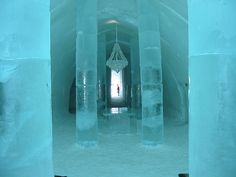 The one of a kind ICEHOTEL in Jukkasjärvi, Sweden.  Most amazing hotel entrance with ice chandelier. At the ABSOLUT ICE BAR they serve drinks in ice glasses. Don't forget your arctic expedition wear because of course there is no heat!