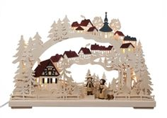 Multiple layers of carved wood create a three-dimensional effect. Intricate details of a winter walk through the village.