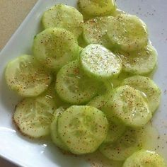 Be careful as these are addictive! Cucumbers with a BANG! Baby cucumbers.  Ingredients:  Baby cucumber  Lemon juice  Olive oil  Salt and pepper  Chile powder  Instructions:  Chop a baby cucumber and add lemon juice, olive oil, salt and pepper and chili powder on top.
