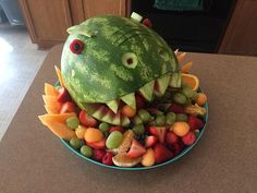 T-Rex Fruit Tray (large) - Using only organic fruit, this T-Rex fruit tray was a roaring success for a 5 year old's dinosaur themed birthday party!