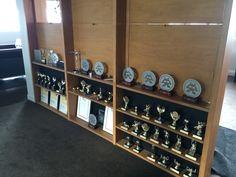 Best Design Awards Gold Pins on display
