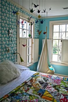 Like the swing chair & the aspect of the oragami's, maybe trinitys room with butterflies instead