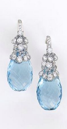 A Pair of Aquamarine and Diamond Earrings.  Each briolette-cut drop-shaped aquamarine, decorated with cascading circular-cut diamond collets to the pavé-set diamond surmount, mounted in 18K white gold, length 4.3 cm.