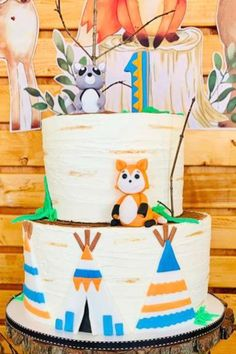 Take a look at the sweet log inspired tiered birthday cake decorated with woodland animalsat this woodland 1st birthday party. See more party ideas and share yours at CatchMyParty.com #catchmyparty #partyideas #4favoritepartiesoftheweek #woodland #woodlandparty #woodlandcake #boy1stbirthdayparty