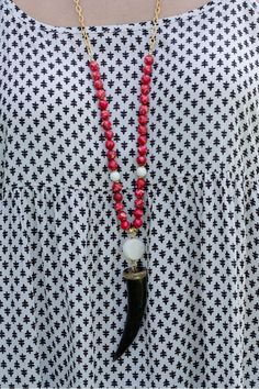Something Wonderful Necklace With a white #druzy link and a black #horn, this necklace is ahhh-mazing!  The red beads add just the right pop of color!