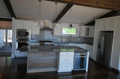 Kitchen island with reclaimed wood.  Grey subway tile.