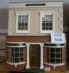 A dolls house with shop front and arranged over two floors est: £40-£60 (AF7)