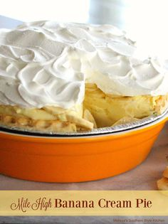 Mile High Banana Cream Pie Just as the name suggests this Mile High Banana Cream Pie boasts an impressive and creamy banana cream filling and topped with billows of whipped cream on top.