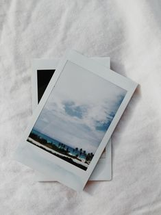 picture of pictures on a bed. interesting.