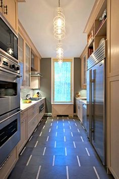 Galley Kitchen by Sophie Harrison -  A double oven, overhead microwave, French door-style industrial refrigerator, and a roomy cooktop are just a few of the appliances that make this kitchen ready to cook. ==>http://www.homeportfolio.com/SlideShow/galley-kitchens/sophie-harrison#