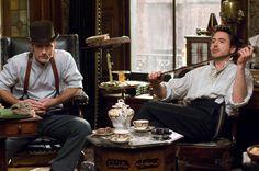 Sherlock Holmes (2009) Downey Jr., Law lounging; Photo Credit: © Warner Bros.