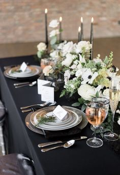 Sophisticated reception set up, black tablecloth and candles, silver plates // Alicia King Photography
