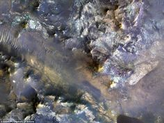 The experts say the features seen in this unnamed crater in Mars' Mare Serpentis region ar...