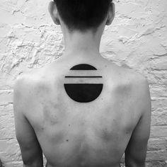 circle tattoo on back