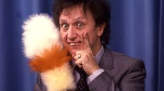 The swept-up hair, protruding teeth and expression of lunatic bewilderment made him one of the UK's most recognised entertainers Spitfire Airplane, Ken Dodd, Nina Simone, Young Life, Website Features, The Old Days, Comedians, Actors & Actresses, Swimming