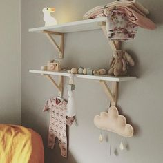 10 of the most stylish wall shelf options for a nursery or child's room on any budget - IKEA shelf styled in a nursery