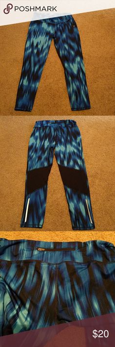 Blue Striped Old Navy athletic leggings Old Navy workout wear. Mesh vents on the back of knees. Reflective strip on outside of lower leg. Zipper in the waistband for keys. Capri length. Only worn a handful of times. No signs of wear or tear. Additional photos available upon request. Old Navy Pants Leggings