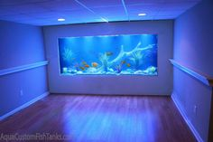 Aqua Creations - Custom Aquarium Wall Fish Tank built into the wall of a residential family room in New York. This fresh water Cichlid Fish tank is designed with a lake / river scene. This 1000 Gallo (Cool Rooms With Water)