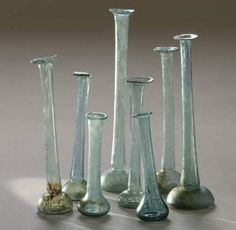 Ancient Roman blown glass perfume containers in excellent condition. Many were colored light green or blue and came in a variety of shapes and sizes. Antique Perfume Bottles, Vintage Bottles, Bottles And Jars, Glass Bottles, Vintage Perfume, Ancient Romans, Antique Glass, Archaeology, Vases