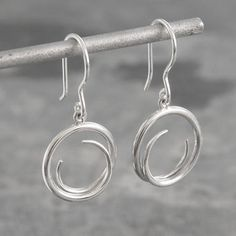 These sterling silver luna earrings are shaped by hand to create an overlapping circle that swings beautifully from the ear. Modern, stylish and contemporary. #Otisjaxon #Jewellery