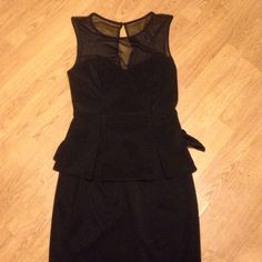 Little black dress! Worn once or twice, size 4 - polyester knit peplum dress with sheer neckline and keyhole back- classy, sleek and slimming Bisou Bisou Dresses