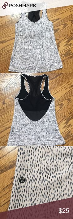 """Lululemon Dance to Yoga Tank. Size 6. Lululemon dance to yoga tank. Size 6.  Support bra built-in.  """"Dottie dash grain black""""  23.5"""" in length.  13.5"""" laid flat armpit to armpit.   Intended to provide light support for B/C cups.  Made with strategically placed mesh fabric ventilation. Designed for yoga, dance and barre.  I took some pictures of the tank inside out so you can see the built-in bra details.  I have the matching skirt to go with this tank available for sale in my store…"""