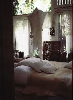 a sanctuary.  This is such a soothing room - the lace on the windows is a wonderful filter for scorching afternoons. I know you're supposed to get your 7+ hours in at night but this would be tempting for an afternoon nap with a slowly whirring fan overhead...