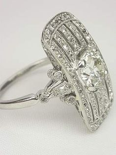 Edwardian platinum and diamond dinner ring.  wow. #SilverJewelry