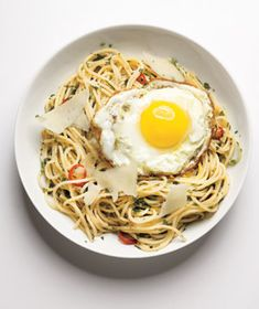 Spaghetti With Herbs, Chilies, and Eggs|Dress up spaghetti with your favorite herbs and sliced red chili peppers for a bit of heat. When you break the egg yolk, it will mix with the warm pasta and create a light, creamy sauce.