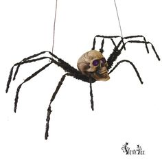 """Skeleton Head Spider Halloween Decoration Size: 20"""" Color: Black, Purple, Smoke Head of spider made of Styrofoam, legs wire and tinsel. Has a long cord for hanging. Legs are in a fixed"""