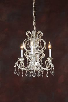 Three-light crystal chandelier on an iron frame with antiqued silverleaf finish…