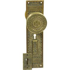 Ornate Knob Set With A Highly Decorative Knob And Back Plate. This Back  Plate Also Has A Decorative Rectangular Key Hole Cover.