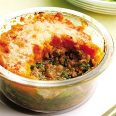 Mini Shepherd's Pies made with beef, winter squash, and spinach in a savory sauce topped with parmesan.