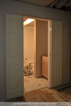 bi-fold closet doors turned into double doors for a small bathroom. use non-mortised hinges to surface mount and save time! add trim on each door edge to mask the gap. add vertical surface mount lock to ensure privacy. - April 28 2019 at Double Doors Interior, Double Barn Doors, Interior Barn Doors, Double Closet Doors, Narrow Closet, Open Closets, Dream Closets, Barn Door In House, Traditional Doors