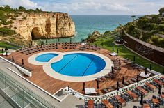 Why Algarve, Portugal Should Be On Your Must-Visit List - via Vogue 01-07-2017   ...no wonder—the sun-soaked, western sliver of southern Europe has much to offer: rich culture, beautiful architecture, and a dazzling culinary scene. (Not to mention the well-styled hotels that are the stuff of social media dreams.) Photo: Tivoli Carvoeiro Algarve Resort's outdoor swimming pool