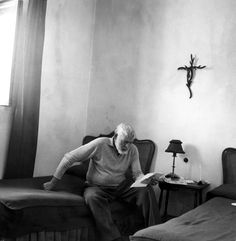 Ernest Hemingway reading a letter at La Consula, Spain, circa 1959 // photo by Mary Hemingway